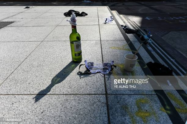 A pair of safety goggles and a Molotov cocktail are seen leftover from protesters who barricaded themselves inside the Hong Kong Polytechnic...