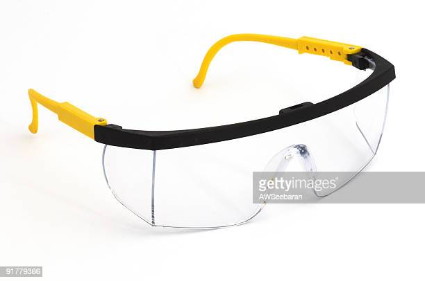 pair of safety goggles on a background - protective eyewear stock pictures, royalty-free photos & images