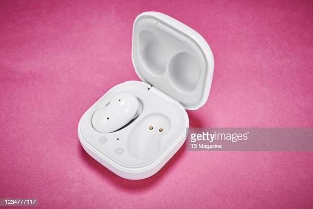 Pair of Samsung Galaxy Buds Live wireless earbuds and charging case, taken on November 2, 2020.