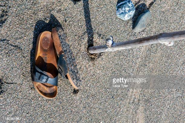A pair of sandals in the sand at Kei Mouth a coastal town on the Wild Coast region of the Eastern Cape Province South Africa