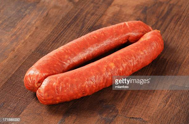 Pair of sausages on a wooden table