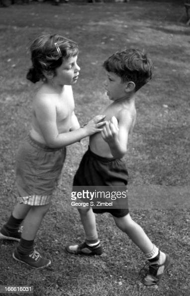 A Pair Of Shirtless Children, A Girl And A Boy, Play -7545