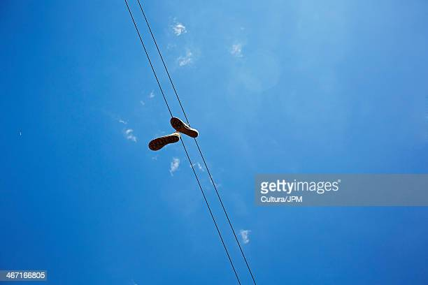 Pair of shoes caught on telephone line