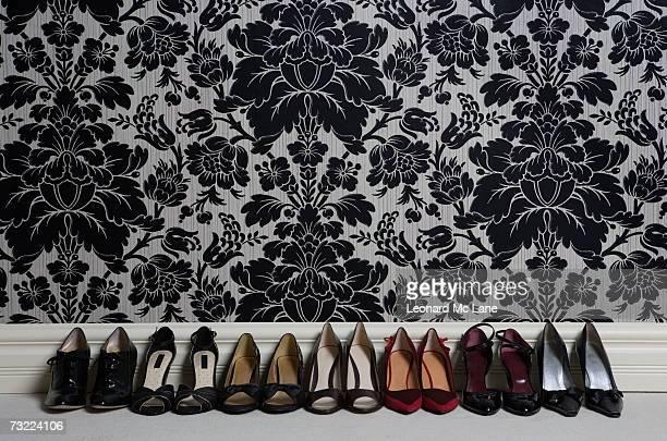 pair of shoes in row against wall, close-up - tacones altos fotografías e imágenes de stock