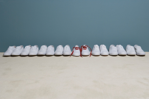 Pair of shoes in row against wall - gettyimageskorea