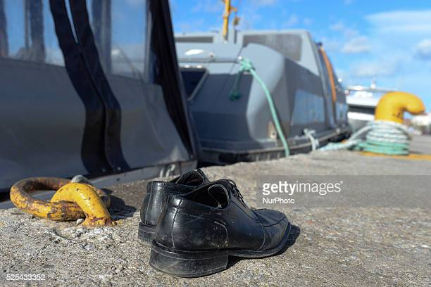 A pair of shoes left near the abandoned boats and dingies used to transport migrants from Turkey in Lesvos Island at Mitilini harbour Mitilini Lesvos...