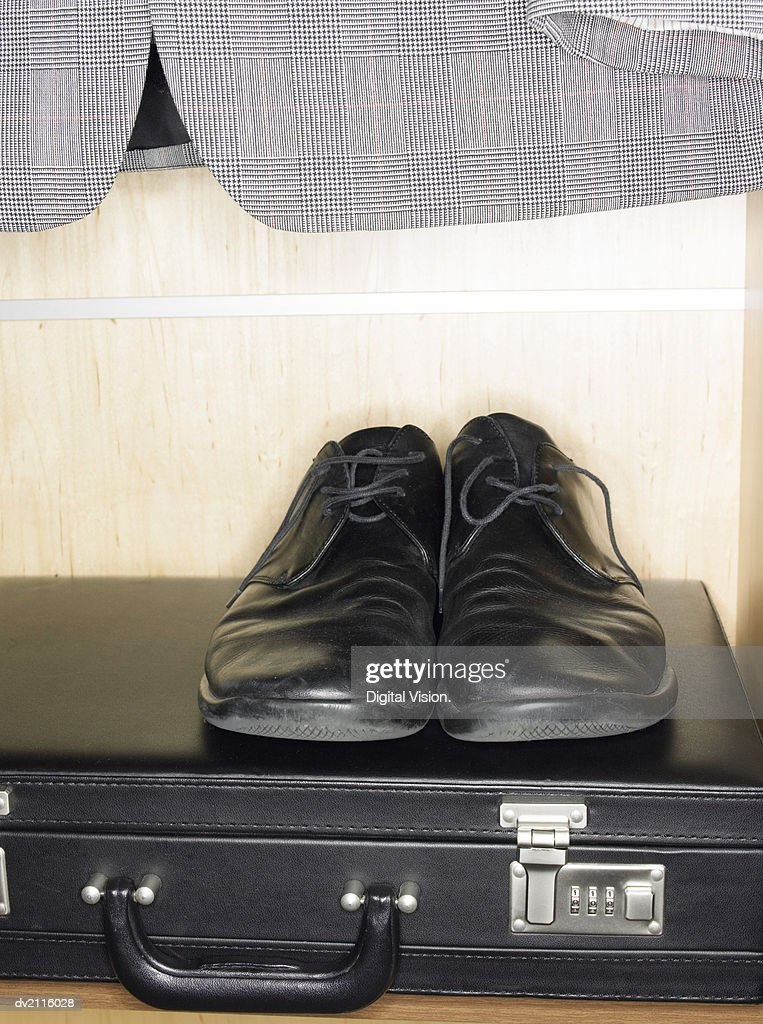 Pair of Shoes on Top of a Briefcase : Stock Photo