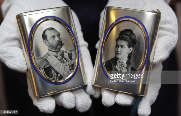 A pair of silver and enamel cigarette cases bearing images of Emperor Alexander II and Grand Duchess Maria Pavlovna is displayed at Sotheby's on...