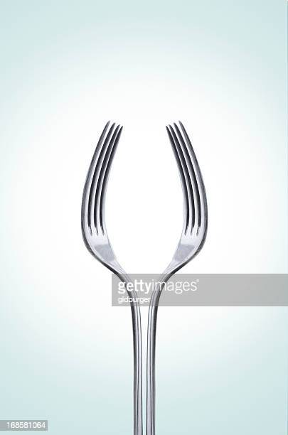 Pair of silver forks facing each other