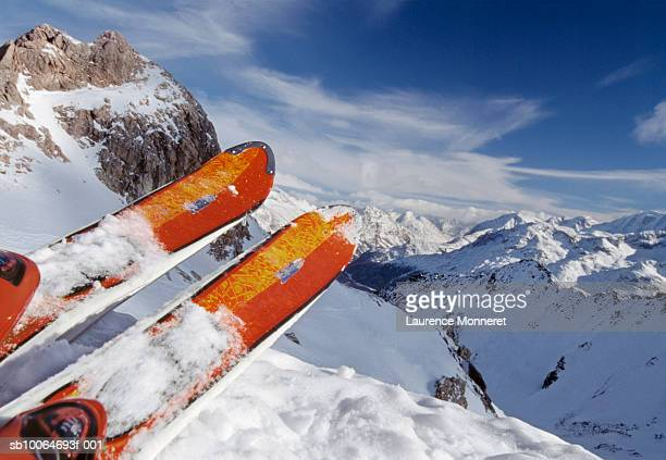 pair of skis on snowy mountain - skiing stock pictures, royalty-free photos & images
