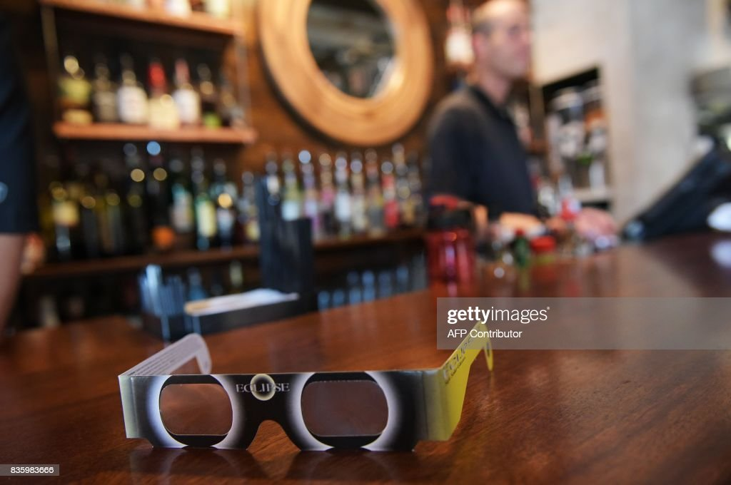 A pair of solar eclipse glasses are seen for sale at a restaurant ahead of the total solar eclipse in Charleston, South Carolina, on August 20, 2017. /