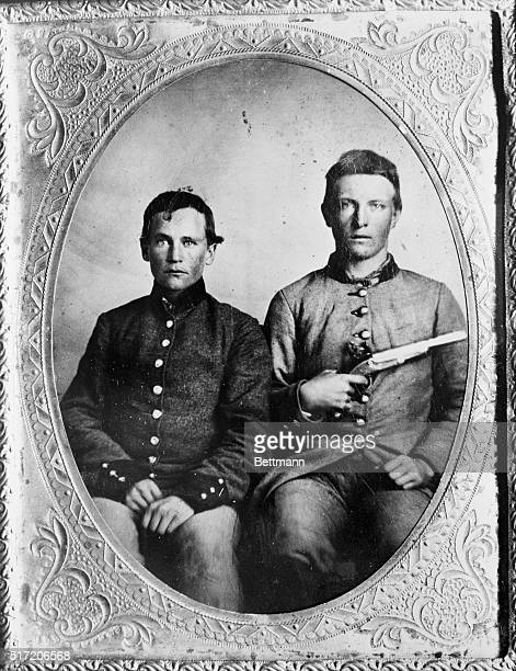 A pair of soldiers of the Confederate States Army one brandishing a flintlock pistol