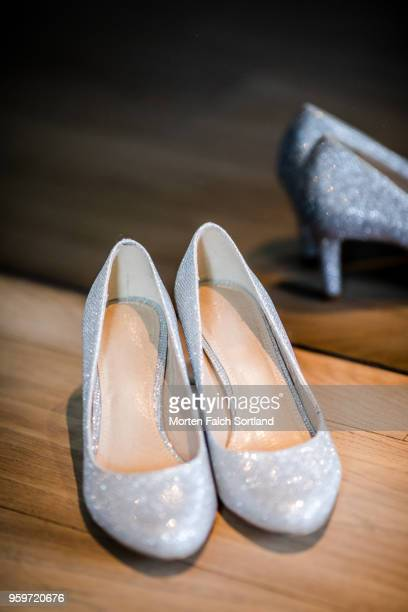 A Pair of Sparkling Wedding Shoes Reflected in a Mirror in Berlin, Germany Summertime