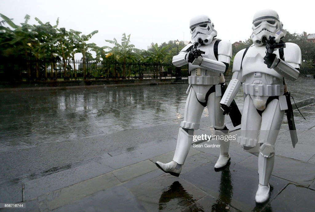 A pair of Stormtroopers walk through Jackson Square in the French Quarter as strong winds and heavy rain from Hurricane Nate begin to come ashore on October 7, 2017 in New Orleans, Louisiana. Nate is expected to make landfall as a category 2 hurricane near Biloxi, Mississippi later this evening.