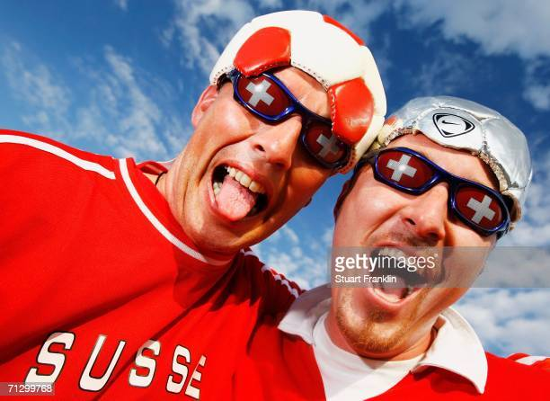 A pair of Swiss fans show off their country's colours prior to the FIFA World Cup Germany 2006 Round of 16 match between Switzerland and Ukraine...