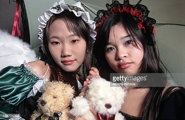 A pair of teenage girls dressed up as modern Japanese comic characters at a 'Cosplay' 'Cosplay' or 'Costume Play' is a Japanese subculture and hobby...