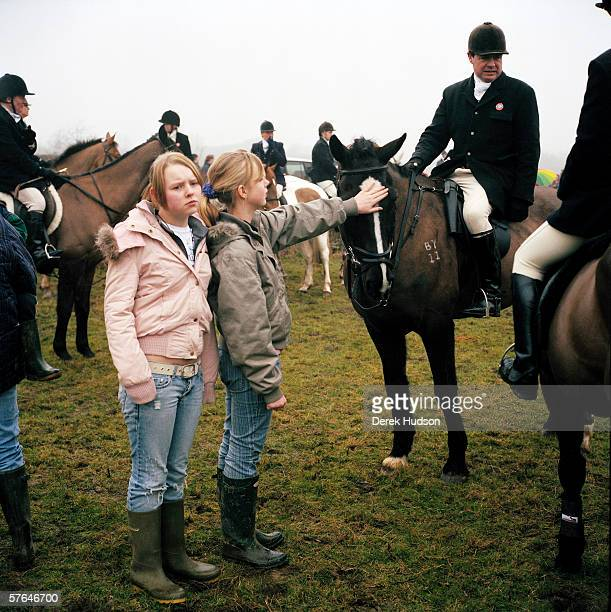 A pair of teenage girls hunt supporters of the Rutland hunt admire huntsmen and women at a meet near the village of Sherbourne prior to setting off...