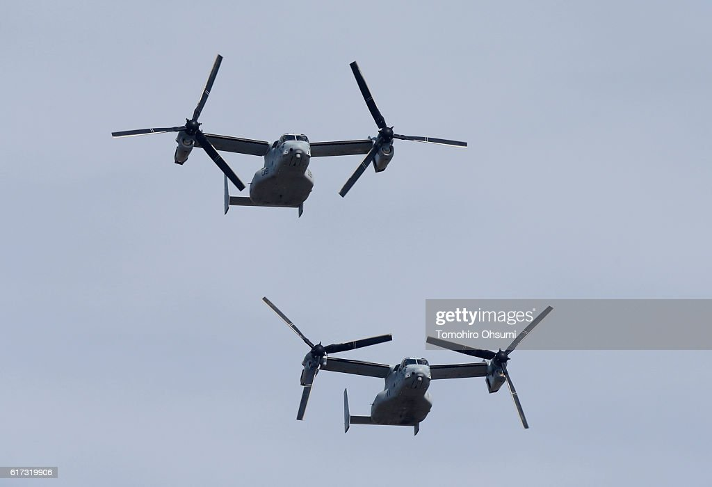 A pair of the V-22 Osprey aircraft fly during the annual review at the Japan Ground Self-Defense Force Camp Asaka on October 23, 2016 in Asaka, Japan.
