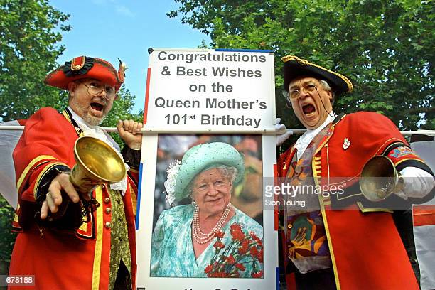 A pair of Town Cryers celebrate the 101st birthday of Britain's Queen Mother August 4 2001 in London