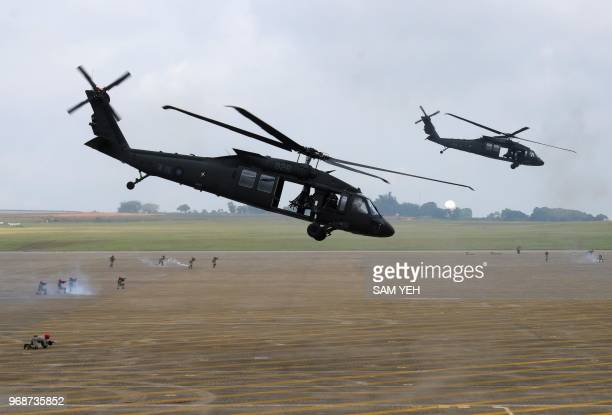 Pair of UH-60 Black Hawk helicopters take part in the Han Kuang drill at the Ching Chuan Kang air force base in Taichung, central Taiwan, on June 7,...