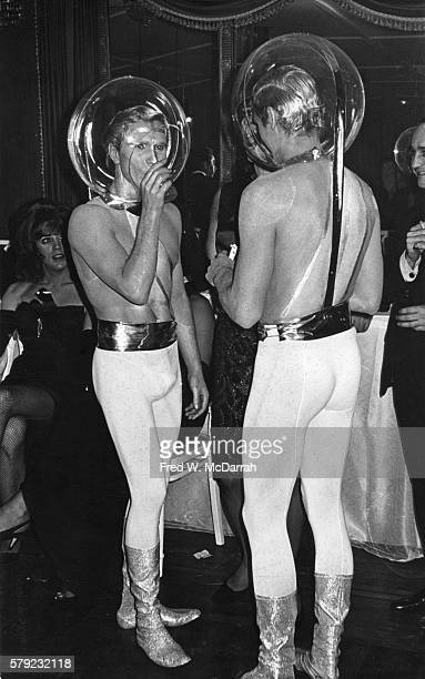 A pair of unidentified partygoers dressed as astronauts or aliens with clear plastic helmets attend a Mattachine Society Ball held at the Hotel...