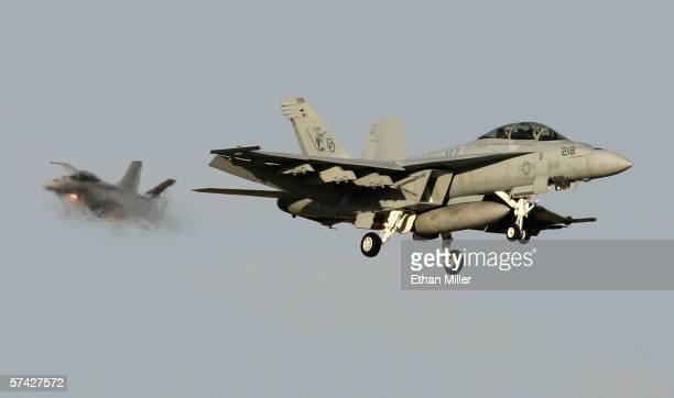 A pair of United States Navy F/A18F Super Hornets land at Nellis Air Force Base while participating in the Joint Expeditionary Force Experiment 2006...