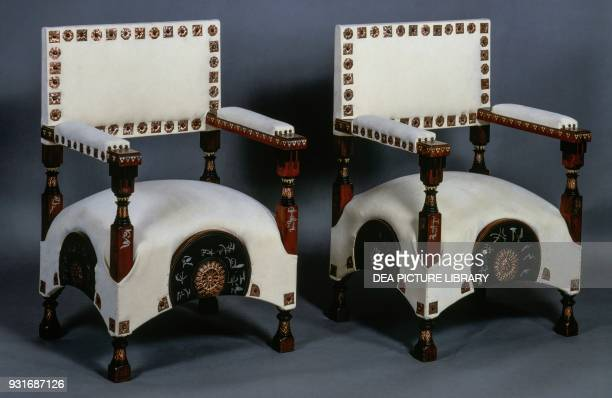 Pair of upholstered armchairs with copper studs ca 1900 by Carlo Bugatti Art Nouveau Italy 20th century