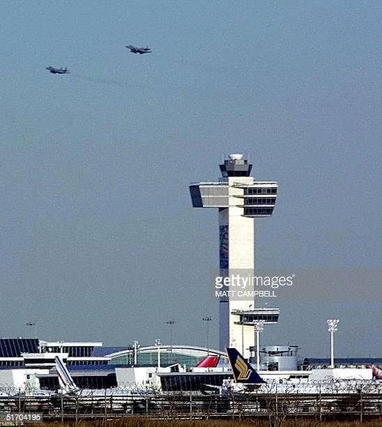 A pair of US Air Force fighter jets that escorted Air India flight 101 pass the control tower at John F Kennedy Airport 28 February in New York City...