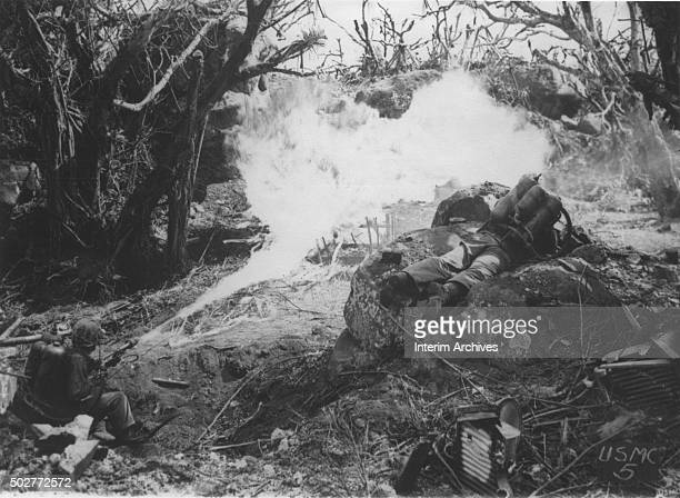 Pair of US Marines aim bursts from their flamethrowers towards enemy positions near Mount Suribachi, Iwo Jima, Japan, 1945.