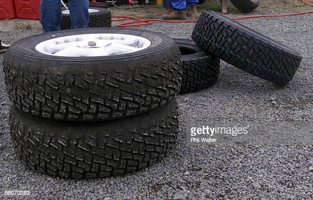 Pair of used rally tyres alongside a fresh set in the pits on day two of the 2000 Rally of New Zealand held on the roads around Maungaturoto,...