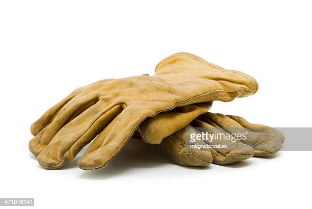 a pair of used, yellow work gloves - work glove stock photos and pictures