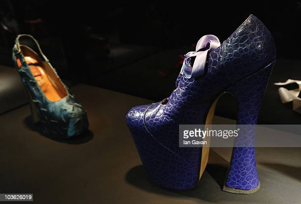 A pair of Vivienne Westwood designed MockCrock Elevated Gilllies from 1993 in which Niomi Campbell famously tripped on the catwalk are displayed...