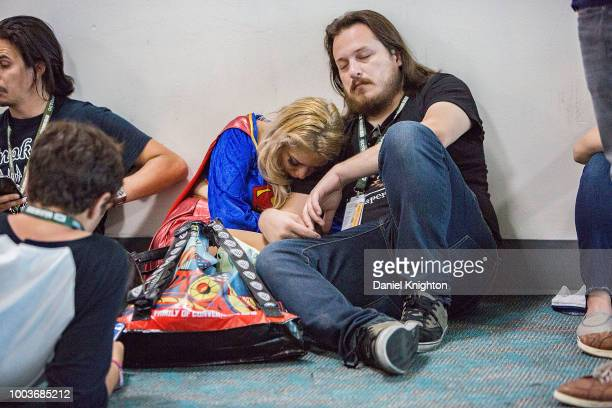 A pair of weary attendees rest at ComicCon International on July 21 2018 in San Diego California