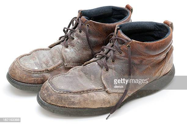 pair of well used, dirty work boots