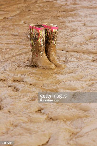 A pair of wellington boots are discarded in the mud on the second day of the Glastonbury Festival at Worthy Farm Pilton near Glastonbury on June 23...
