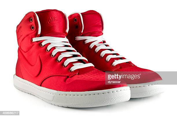 pair of women's nike trainers - nike sports shoe stock pictures, royalty-free photos & images