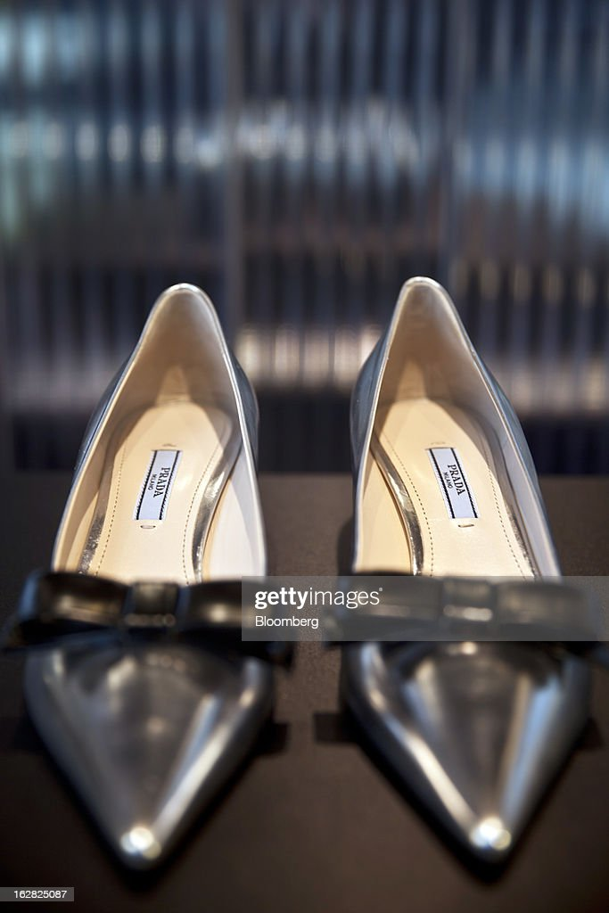A pair of women's shoes by Prada are seen in a store window, operated by Prada SpA, in Berlin, Germany, on Wednesday, Feb. 27, 2013. German unemployment unexpectedly fell in February amid signs that Europe's biggest economy is returning to growth after a contraction at the end of last year. Photographer: Balint Porneczi/Bloomberg via Getty Images