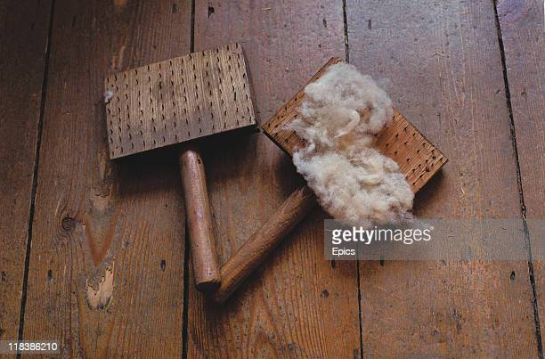 Pair of wool combs which were used for spinning the fibres, on display in the guildhall, Lavenham, Suffolk, England, photo circa 1990.