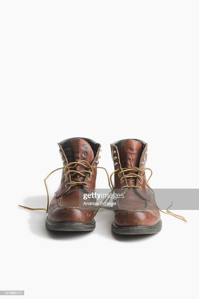 A pair of worn work boots : Stock Photo