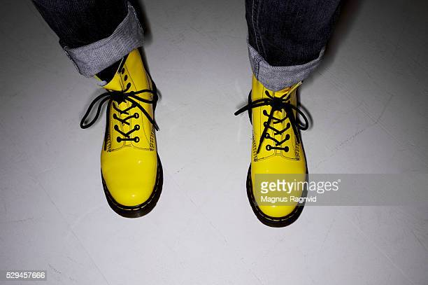 a pair of yellow shoes, denmark - yellow shoe stock photos and pictures