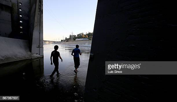LOS ANGELES CALIF MAR 25 2015 A pair of youths access the Los Angeles River beneath the Pasadena Freeway near downtown Los Anggeles City budget...