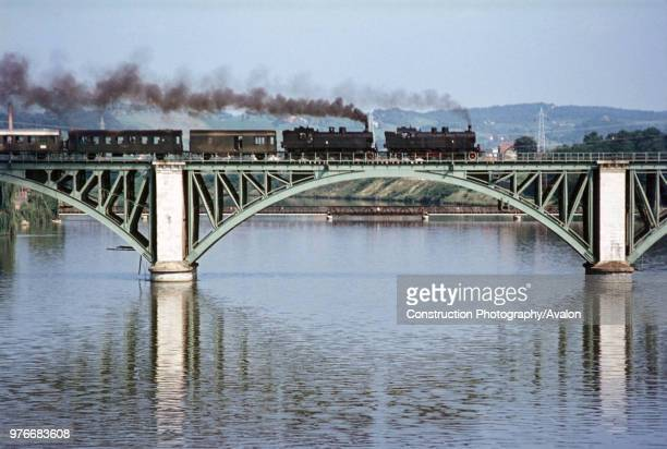 A pair of Yugoslav Railways 18 Class 462Ts doubled head a midday train to Bleibury across the viaduct at Maribor on Wednesday 23 August 1972