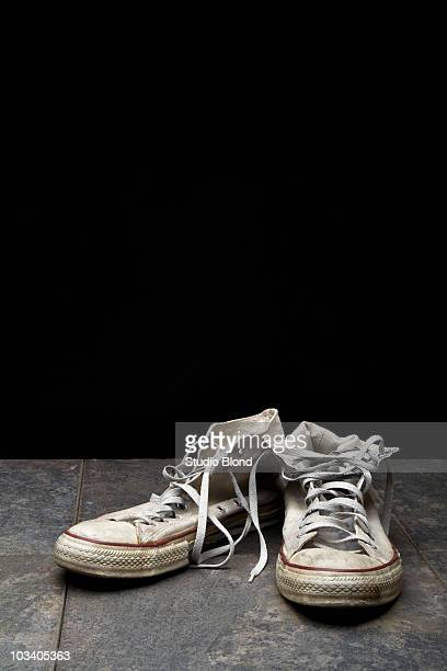 a pair on canvas shoes - white shoe stock pictures, royalty-free photos & images