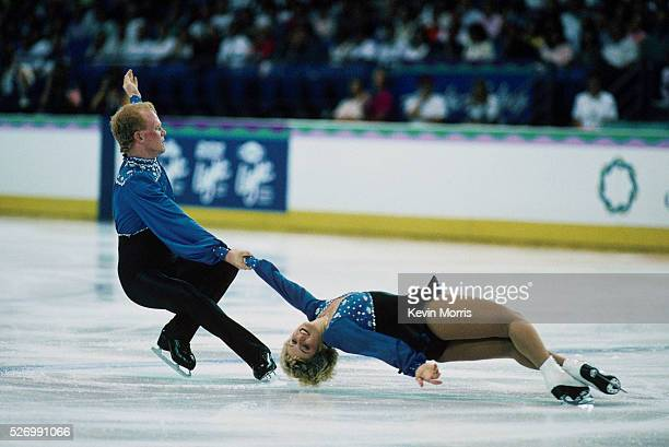 A pair performs a death spiral spin in the pairs figure skating competition at the 1990 Goodwill Games Tacoma Dome Tacoma Washington USA