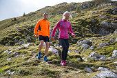 Pair running down the mountain