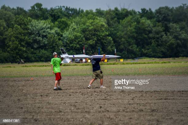CONTENT] A pair walk their highpowered rocket out to the launch pad at the Upstate Research Rocketry Festival in Potter New York in summer 2013