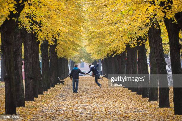 Pair walking through a picturesque alley
