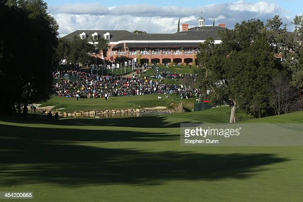 Pairing plays on the 18th green during the third round of the Northwestern Mutual World Challenge at Sherwood Country Club on December 7, 2013 in...