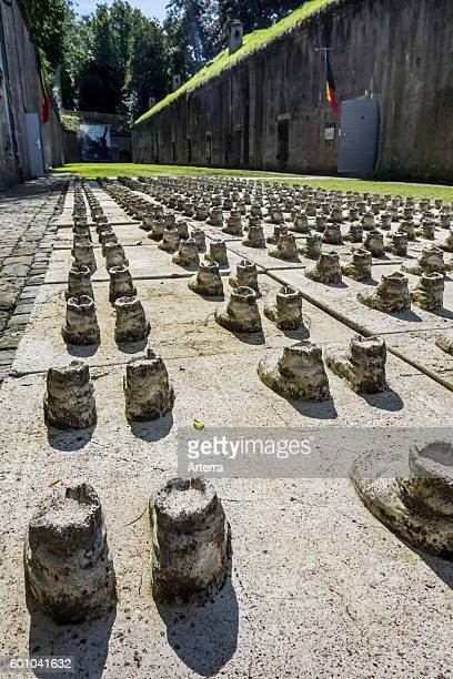 Pairs of boots remembering the soldiers who are still buried under the debris of the exploded Fort de Loncin one of twelve forts built as part of the...