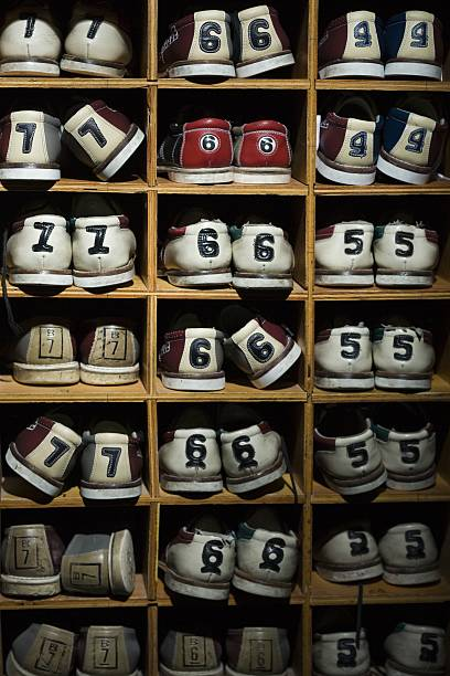 Pairs of bowling shoes on a shelf
